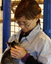 Dr Cypher holding a rescued cat.